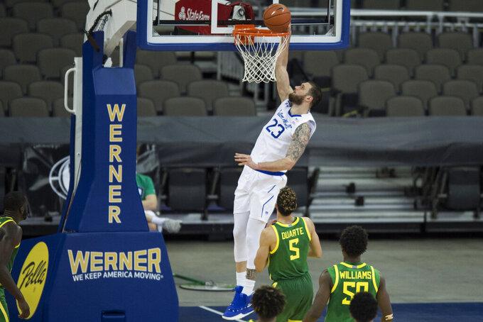 Seton Hall's Sandro Mamukelashvili scores over Oregon's Chris Duarte against during the second half of an NCAA college basketball game in Omaha, Neb., Friday, Dec. 4, 2020. (AP Photo/Kayla Wolf)