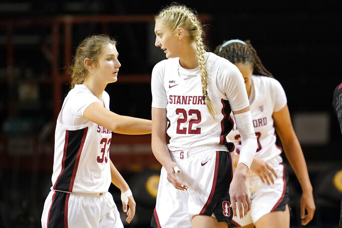 Stanford forward Cameron Brink (22) celebrates after scoring against Southern California with teammates Hannah Jump, left, and Haley Jones during the second half of an NCAA college basketball game in Santa Cruz, Calif., Sunday, Jan. 24, 2021. (AP Photo/Jeff Chiu)