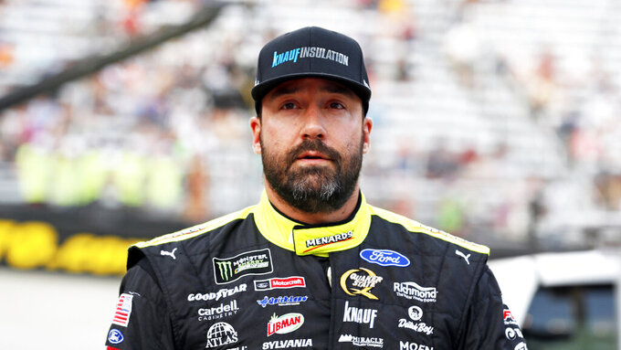 Driver Paul Menard walks to his car before a NASCAR Cup Series auto race, Saturday, Aug. 17, 2019, in Bristol, Tenn. (AP Photo/Wade Payne)