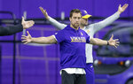 FILE - In this April 16, 2019, file photo, Minnesota Vikings wide receiver Adam Thielen stretches before practice at the Twin Cities Orthopedic Center in Eagan, Minn. The Chicago Bears, Tennessee Titans and Los Angeles Rams all decided to end their offseason programs even with the NFL allowing two more weeks to keep working.  So did the Houston Texans, Arizona Cardinals and Washington Redskins. Turns out there's only so much that can be done virtually. (Elizabeth Flores/Star Tribune via AP, File)