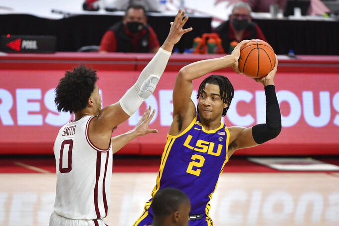 LSU forward Trendon Watford (2) tries to get past Arkansas forward Justin Smith (0) during the second half of an NCAA college basketball game in Fayetteville, Ark. Saturday, Feb. 27, 2021. (AP Photo/Michael Woods)