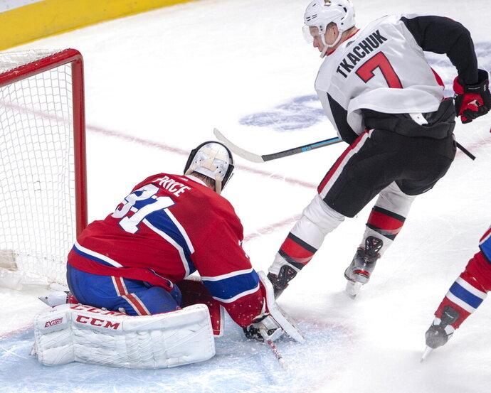 Ottawa Senators left wing Brady Tkachuk (7) scores the winning goal against Montreal Canadiens goaltender Carey Price (31) during overtime NHL hockey action in Montreal, Wednesday, Nov. 20, 2019. (Ryan Remiorz/The Canadian Press via AP)