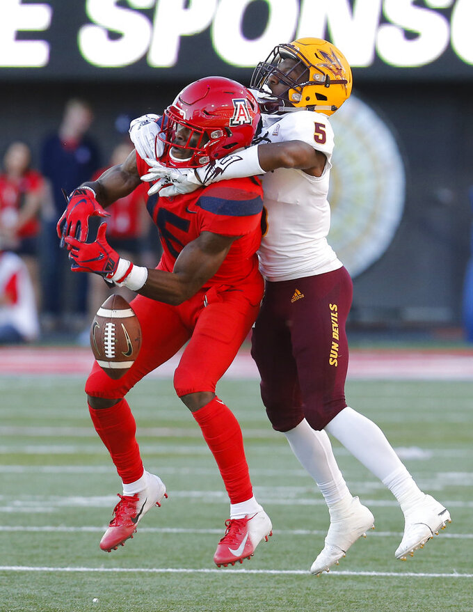 Arizona State defensive back Kobe Williams (5) breaks up a pass intended for Arizona wide receiver Will Gunnell in the second half during an NCAA college football game, Saturday, Nov. 24, 2018, in Tucson, Ariz. (AP Photo/Rick Scuteri)
