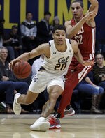 California's Matt Bradley (20) moves the ball ahead of Washington State's Tony Miller, right, during the second half of an NCAA college basketball game Thursday, Jan. 9, 2020, in Berkeley, Calif. (AP Photo/Ben Margot)