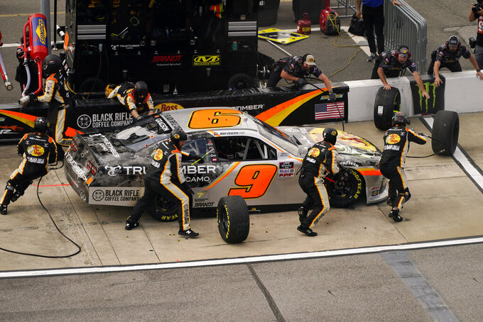Noah Gragson (9) gets service in the pits during the NASCAR Xfinity auto race in Richmond, Va., Saturday, Sept. 11, 2021. (AP Photo/Steve Helber)