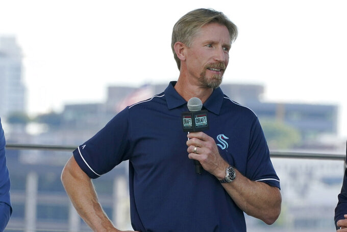 Seattle Kraken coach Dave Hakstol speaks Wednesday, July 21, 2021, during the team's NHL hockey expansion draft event in Seattle. (AP Photo/Ted S. Warren)