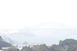 In this Tuesday, Dec. 3, 2019, file photo, smoke haze from wildfires fills the skyline in Sydney, Australia. The annual Australian fire season normally peaks during the Southern Hemisphere summer, but has started early after an unusually warm and dry winter. (AP Photo/Rick Rycroft, File)