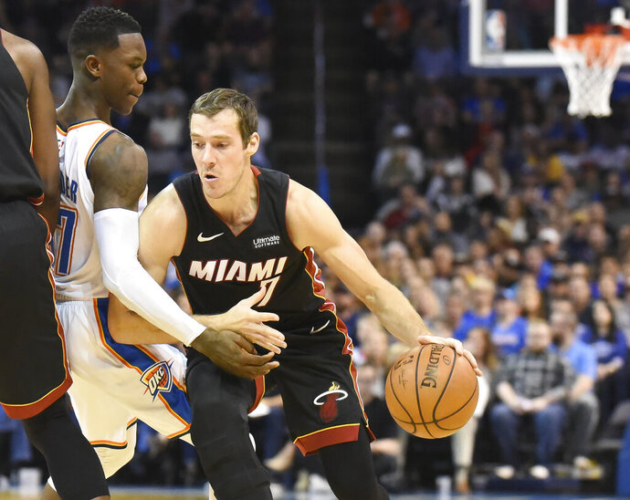 Miami Heat guard Goran Dragic, right, drives past Oklahoma City Thunder guard Dennis Schroder, left, in the first half of an NBA basketball game against Miami Heat, Monday, March 18, 2019, in Oklahoma City. (AP Photo/Kyle Phillips)