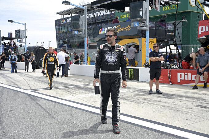 Driver Tommy Joe Martins walks to his vehicle on pit road before a NASCAR Xfinity Series auto race at Daytona International Speedway, Saturday, Aug. 28, 2021, in Daytona Beach, Fla. (AP Photo/Phelan M. Ebenhack)