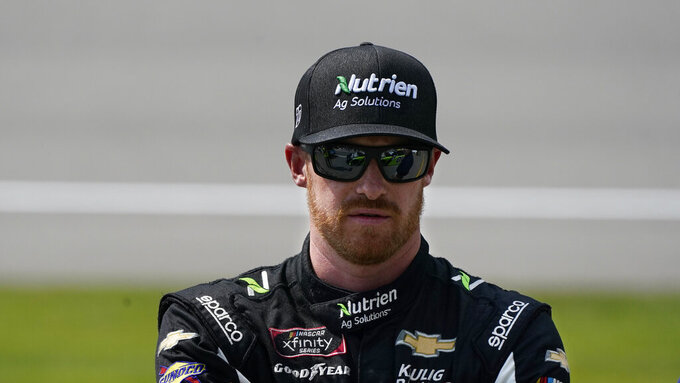 Jeb Burton is seen before the NASCAR Xfinity Cup Series auto race at Michigan International Speedway, Saturday, Aug. 21, 2021, in Brooklyn, Mich. (AP Photo/Carlos Osorio)