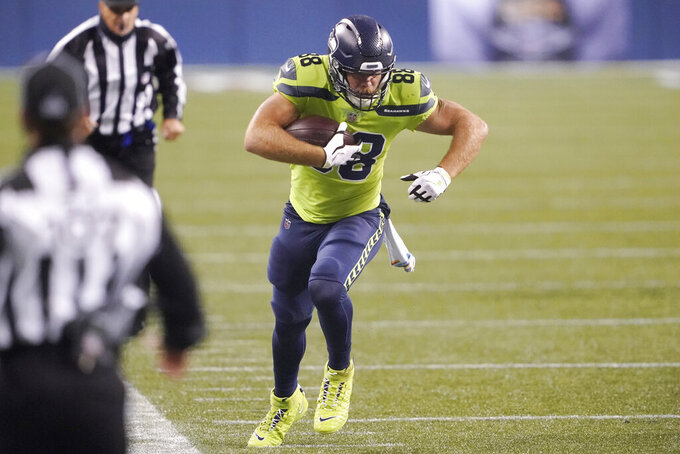 Seattle Seahawks tight end Greg Olsen runs with the ball against the Minnesota Vikings during the second half of an NFL football game, Sunday, Oct. 11, 2020, in Seattle. (AP Photo/Ted S. Warren)