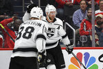 Los Angeles Kings center Jeff Carter (77) celebrates his goal with Carl Grundstrom (38) during the first period of an NHL hockey game against the Washington Capitals, Tuesday, Feb. 4, 2020, in Washington. (AP Photo/Nick Wass)