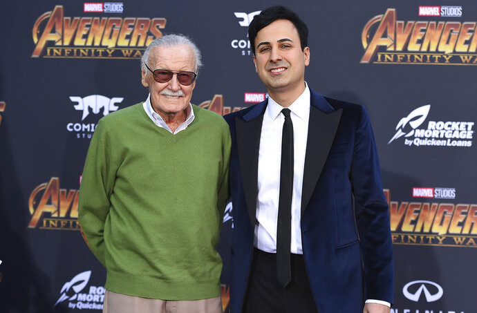 FILE - In this April 23, 2018 file photo, Stan Lee, left, and Keya Morgan arrive at the world premiere of