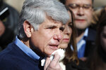 Former Illinois Gov. Rod Blagojevich dabs blood from his chin during a news conference outside his home Wednesday, Feb. 19, 2020, in Chicago. On Tuesday, President Donald Trump commuted Blagojevich's 14-year prison sentence for political corruption. Blagojevich joked that it was the first time in a long time he has shaved with a normal razor. (AP Photo/Charles Rex Arbogast)