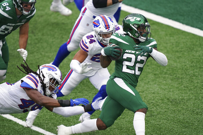New York Jets' La'Mical Perine, right, runs the ball for a touchdown during the first half of an NFL football game against the Buffalo Bills, Sunday, Oct. 25, 2020, in East Rutherford, N.J. (AP Photo/John Minchillo)