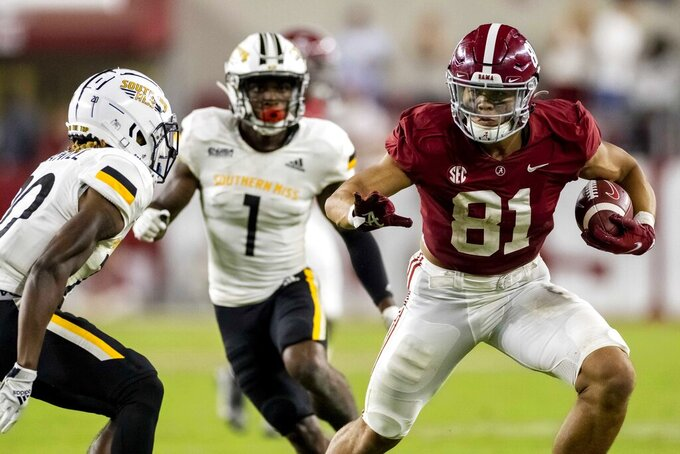 Alabama tight end Cameron Latu (81) works by Southern Mississippi defensive back Lakevias Daniel (20) during the second half of an NCAA college football game, Saturday, Sept. 25, 2021, in Tuscaloosa, Ala. (AP Photo/Vasha Hunt)