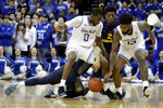 Seton Hall guard Quincy McKnight (0) and teammate guard Myles Powell (13) compete for the ball against Marquette guard Markus Howard, bottom, and teammate forward Sacar Anim (2) during the first half of an NCAA college basketball game, Wednesday, March 6, 2019, in Newark, N.J. (AP Photo/Julio Cortez)