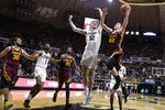 Purdue center Matt Haarms (32) goes up to block the shot ov Minnesota forward Michael Hurt (42) during the first half of an NCAA college basketball game in West Lafayette, Ind., Thursday, Jan. 2, 2020. (AP Photo/Michael Conroy)