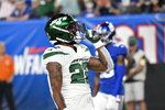 New York Jets running back La'Mical Perine celebrates after scoring a touchdown in the first half of an NFL preseason football game against the New York Giants, Saturday, Aug. 14, 2021, in East Rutherford, N.J. (AP Photo/Corey Sipkin)