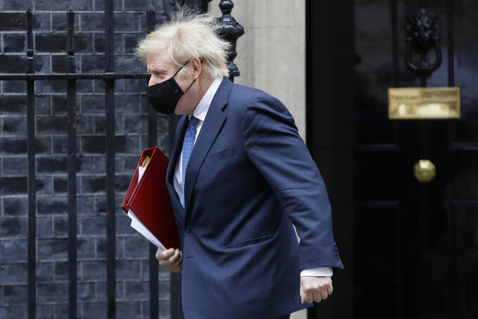Britain's Prime Minister Boris Johnson leaves 10 Downing Street to attend the weekly session of PMQs in Parliament in London, Wednesday, March 10, 2021. (AP Photo/Kirsty Wigglesworth)