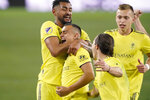 Nashville SC forward Randall Leal, lower left, is congratulated after scoring a goal against Inter Miami during the first half of an MLS soccer playoff match Friday, Nov. 20, 2020, in Nashville, Tenn. (AP Photo/Mark Humphrey)