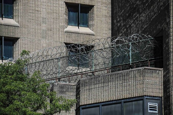 FILE - This Aug. 10, 2019, shows razor wire fencing at the Metropolitan Correctional Center in New York. The U.S. government said Thursday, Aug. 26, 2021, it is shutting down the embattled federal jail in New York City after a slew of problems that came to light following Jeffrey Epstein's suicide there two years ago. (AP Photo/Bebeto Matthews, File)