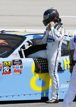 Dale Earnhardt Jr gets in his car before qualifying for the NASCAR Xfinity Series auto race at Darlington Raceway on Saturday, Aug. 31, 2019, in Darlington, S.C.. (AP Photo/Terry Renna)