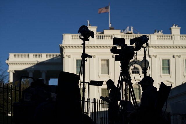 FILE - In this Nov. 4, 2020, file photo, media organizations set up outside the White House in Washington. The Associated Press and the major TV networks have long played a major role in announcing the victor in elections based on their own data. There is no national elections commission to tell the world who wins on election day, unlike in many other countries. Instead, the news media has historically stepped into this role — a tradition that evolved from the simple need to report the news.  (AP Photo/Evan Vucci, File)