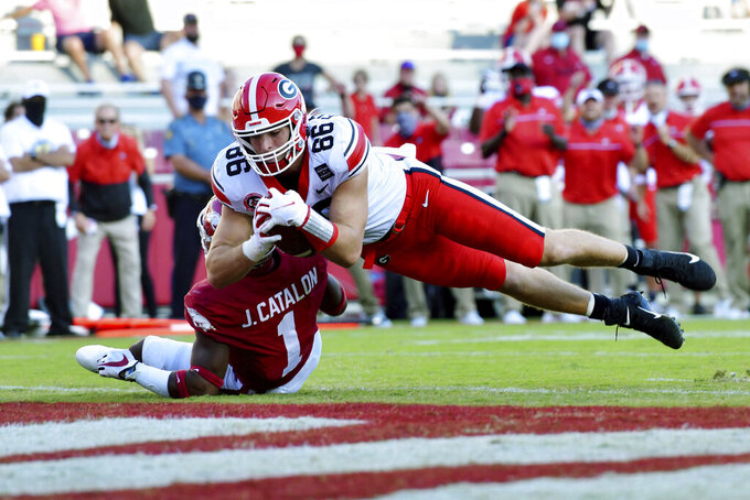Georgia tight end John FitzPatrick (86) dives into the end zone past Arkansas defender Jalen Catalon (1) to score a touchdown during the second half of an NCAA college football game in Fayetteville, Ark., Saturday, Sept. 26, 2020. (AP Photo/Michael Woods)