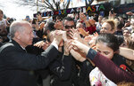 Turkey's President Recep Tayyip Erdogan shakes hands with the supporters of his ruling Justice and Development Party during a rally in Eregli, Turkey, Tuesday, March 19, 2019. Ignoring widespread criticism, Erdogan has again shown excerpts of a video taken by the attacker who killed 50 people in mosques in New Zealand at a campaign rally.(Presidential Press Service via AP, Pool)