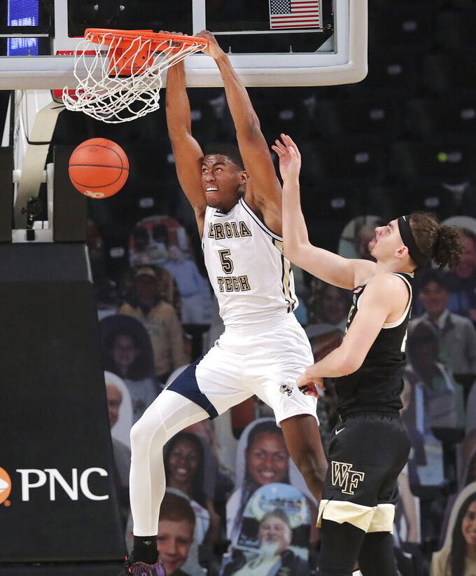 Georgia Tech forward Moses Wright dunks for two past Wake Forest forward Ismael Massoud during an NCAA college basketball game on Sunday, Jan. 3, 2021, in Atlanta.  (Curtis Compton/Atlanta Journal-Constitution via AP)