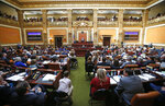 FILE - In this Jan. 28, 2019, file photo, the floor of the Utah House of Representatives is shown during the first day of the Utah legislative session, in Salt Lake City. Utah lawmakers are expected to meet Monday night, Sept. 16 to consider changes to the state's medical marijuana law, an issue that has faced fierce criticism from people on both sides of the debate. The proposed changes include scrapping plans for an unusual state-run dispensary system and adopting protections for patients who are concerned they could be prosecuted for drug crimes. (AP Photo/Rick Bowmer, File)