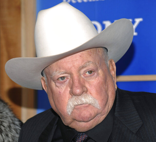 "FILE - In this Monday, Dec. 14, 2009 file photo, Actor Wilford Brimley attends the premiere of 'Did You Hear About The Morgans' at the Ziegfeld Theater in New York. Wilford Brimley, who worked his way up from stunt performer to star of film such as ""Cocoon"" and ""The Natural,"" has died. He was 85. Brimley's manager Lynda Bensky said the actor died Saturday morning, Aug. 1, 2020 in a Utah hospital. (AP Photo/Evan Agostini, File)"