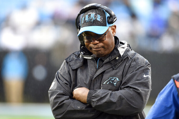 Carolina Panthers head coach Perry Fewell walks the sidelines during the second half of an NFL football game against the New Orleans Saints in Charlotte, N.C., Sunday, Dec. 29, 2019. (AP Photo/Mike McCarn)
