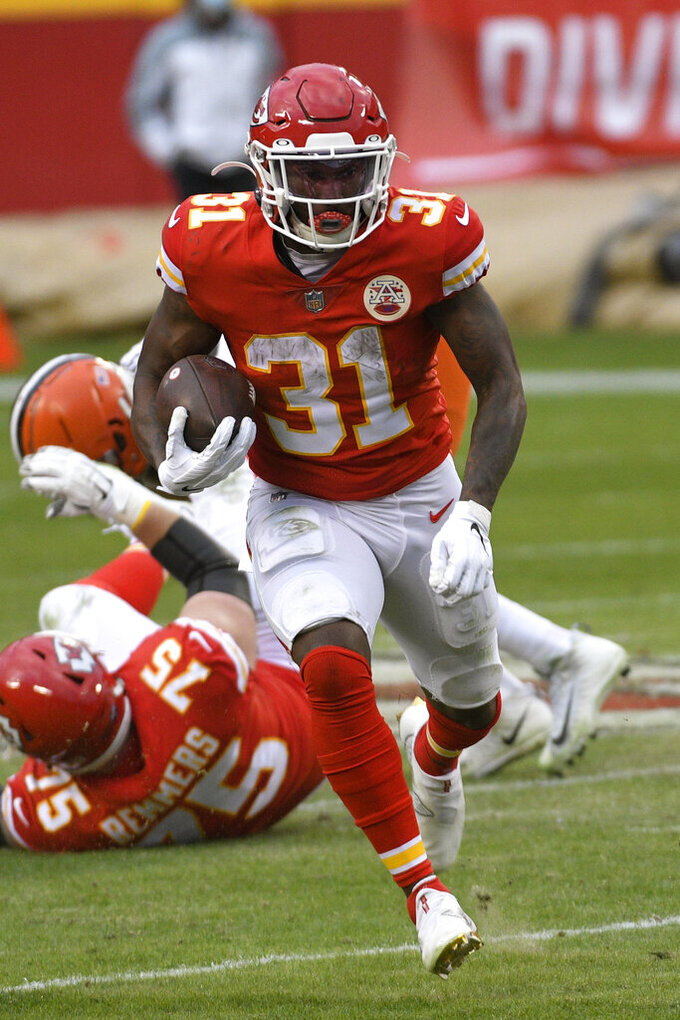 Kansas City Chiefs running back Darrel Williams carries the ball up field during the second half of an NFL divisional round football game against the Cleveland Browns, Sunday, Jan. 17, 2021, in Kansas City. (AP Photo/Reed Hoffmann)