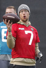 Jaguars QB Nick Foles holds a ball during a NFL training session of the Jacksonville Jaguars at the at Allianz Park in London, Friday, Nov. 1, 2019. The Jacksonville Jaguars are preparing for an NFL regular season game against the Houston Texans in London on Sunday. (AP Photo/Frank Augstein)