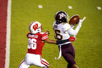 Minnesota defensive back Coney Durr (16) intercepts a pass intended for Wisconsin wide receiver Devin Chandler (86) during the second half of an NCAA college football game Saturday, Dec. 19, 2020, in Madison, Wis. (AP Photo/Andy Manis)