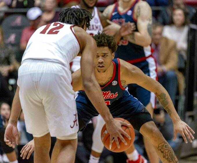 Mississippi guard Breein Tyree (4) looks down Alabama guard Dazon Ingram (12) while setting the defense during the first half of an NCAA college basketball game, Tuesday, Jan. 22, 2019, in Tuscaloosa, Ala. (AP Photo/Vasha Hunt)