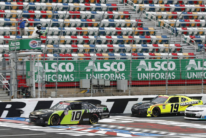 Ross Chastain (10) leads Brandon Jones (19) as they pass under the green flag to start a NASCAR Xfinity Series auto race at Charlotte Motor Speedway Monday, May 25, 2020, in Concord, N.C. (AP Photo/Gerry Broome)