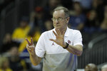 Oklahoma head coach Lon Kruger talks to his players during the first half of an NCAA college basketball game against Stanford Monday, Nov. 25, 2019, in Kansas City, Mo. (AP Photo/Charlie Riedel)
