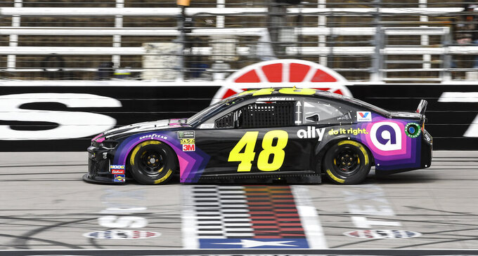 Driver Jimmie Johnson races down the front stretch during practice for a NASCAR Cup auto race at Texas Motor Speedway, Saturday, March 30, 2019, in Fort Worth, Texas. (AP Photo/Larry Papke)