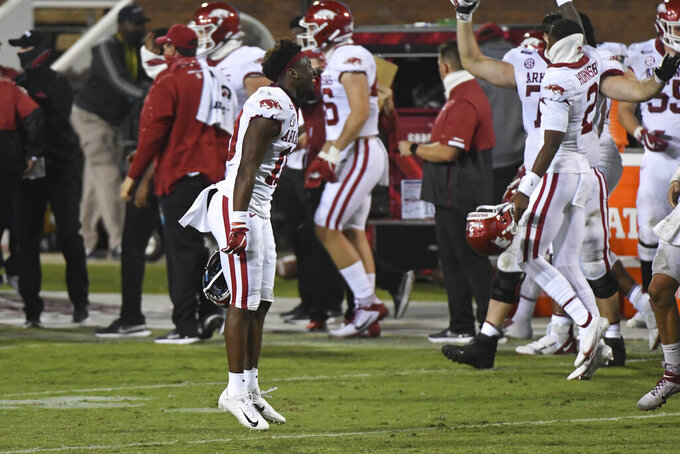 Arkansas wide receiver De'Vion Warren (10) celebrates during the second half of the team's NCAA college football game against Mississippi State in Starkville, Miss., Saturday, Oct. 3, 2020. Arkansas won 21-14. (AP Photo/Thomas Graning)