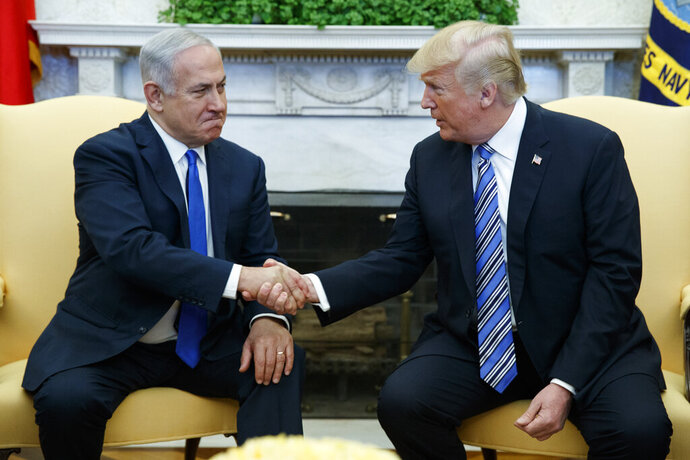 FILE - In this March 5, 2018, file photo, President Donald Trump meets with Israeli Prime Minister Benjamin Netanyahu in the Oval Office of the White House in Washington. Trump and Netanyahu have had a mutually beneficial relationship unlike perhaps that of any previous leader of either country, with Trump's surprise recognition of Israel's sovereignty over the Golan Heights just the most recent example. Trump's precedent-breaking steps have boosted his own profile with pro-Israel groups in the U.S. and given a boost to Netanyahu at the height of campaigning in the unexpectedly tense Israeli election. (AP Photo/Evan Vucci, File)