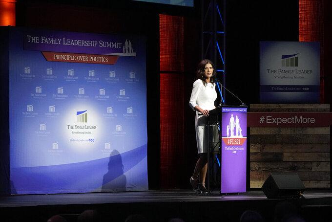 South Dakota Gov. Kristi Noem speaks during the Family Leadership Summit, Friday, July 16, 2021, in Des Moines, Iowa. (AP Photo/Charlie Neibergall)