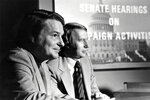 This 1973 image released by PBS shows co-anchors Jim Lehrer, left, and Robert MacNeil reporting on the Watergate hearings. PBS announced that Lehrer died Thursday, Jan. 23, 2020, at home. He was 85. (PBS via AP)