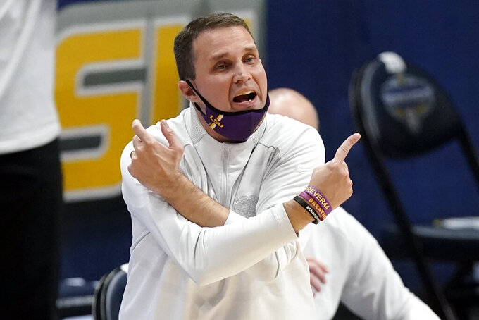 FILE - In this March 13, 2021, file photo, LSU head coach Will Wade yells to his players in the first half of an NCAA college basketball game against Arkansas in the Southeastern Conference Tournament in Nashville, Tenn. Wade dove aggressively into the college basketball transfer market to address the loss of four starters from last season including top scorer Cam Thomas. (AP Photo/Mark Humphrey, File)