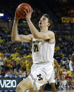 Michigan guard Franz Wagner makes a layup during the second half of the team's NCAA college basketball game against Indiana, Sunday, Feb. 16, 2020, in Ann Arbor, Mich. (AP Photo/Carlos Osorio)