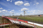This Wednesday, April 22, 2020 photo, dshows Park Jefferson International Speedway in North Sioux City, S.D. The track will practice social distancing while allowing 700 people to attend. The track has sold out of the 700 tickets it offered to a track that usually holds 4,000, for Saturday's race. They are taking steps to reduce the chances that the event will become a hotbed of coronavirus transmission, including keeping the crowds well below capacity, screening people's temperatures and making concessions cashless. (Abigail Dollins/The Argus Leader via AP)