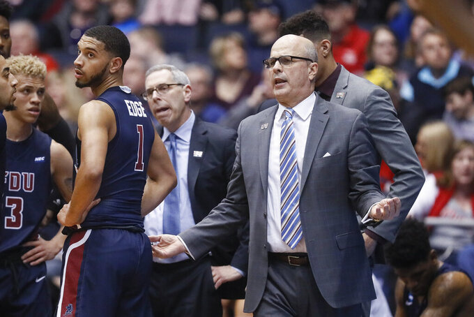 Fairleigh Dickinson head coach Greg Herenda gestures during the first half of a First Four game of the NCAA college basketball tournament against Prairie View A&M, Tuesday, March 19, 2019, in Dayton, Ohio. (AP Photo/John Minchillo)
