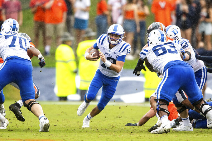 Duke quarterback Gunnar Holmberg (12) runs with the ball during the second quarter of the team's NCAA football game against Virginia on Saturday, Oct. 16, 2021, in Charlottesville, Va. (AP Photo/Mike Caudill)